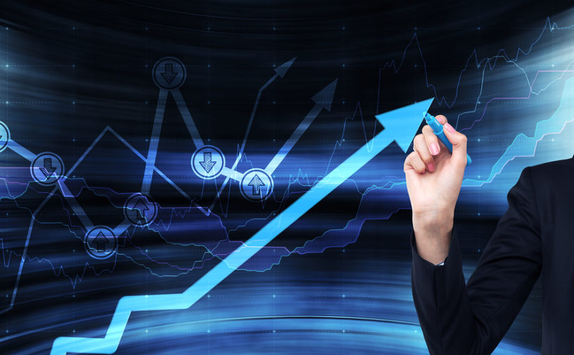 A hand is drawing a growing arrow on the glass scree Blue dark background with financial graphs.